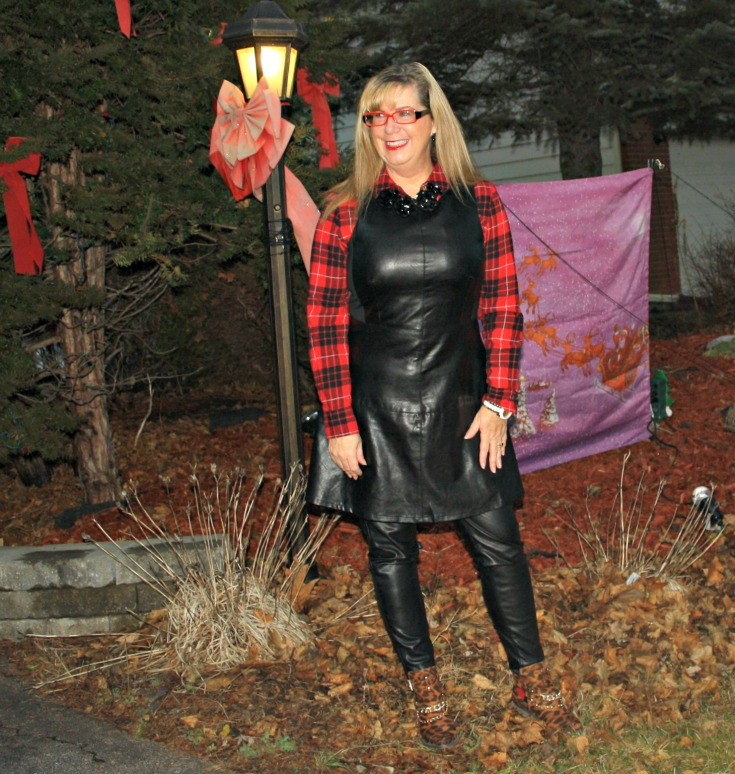 mature woman in leather dress and leather pants