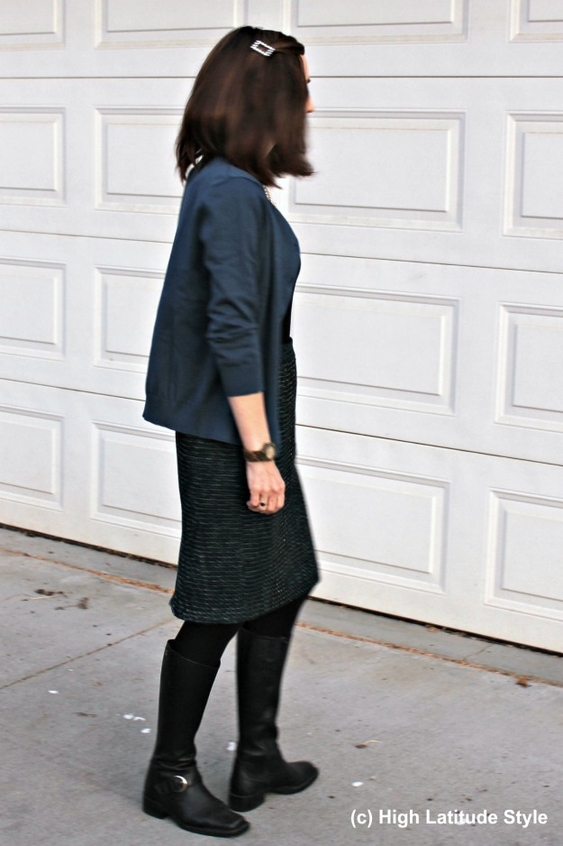 mature woman in color coordinated top, jacket with tweed skirt