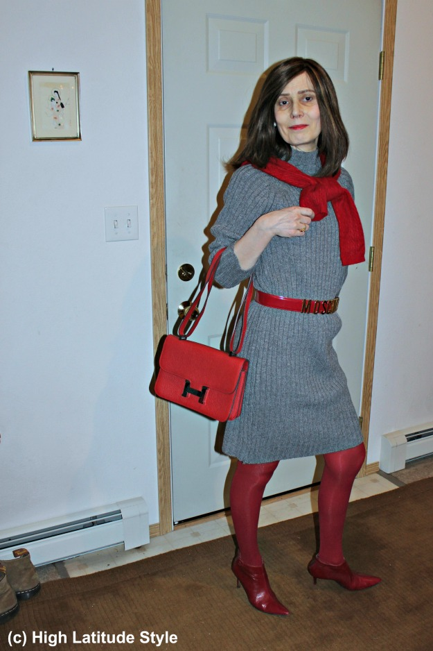 #fashionover50 middle aged lady wearing a chic sweater dress with Moschino belt
