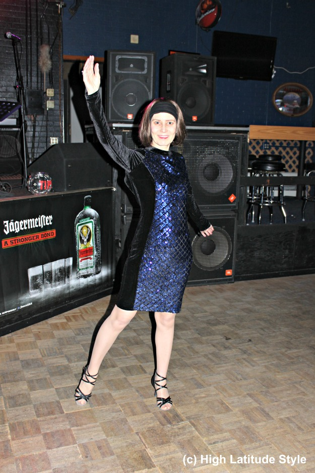 style blogger over 50 in royal blue and black sequin and velvet semi-formal dress