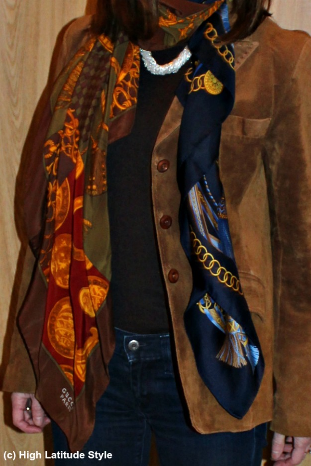 close-up showing how to wear two scarves as one