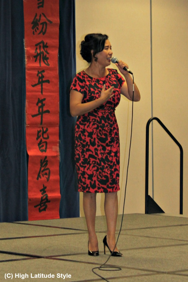 over 40 years old woman in red and black sheath dress