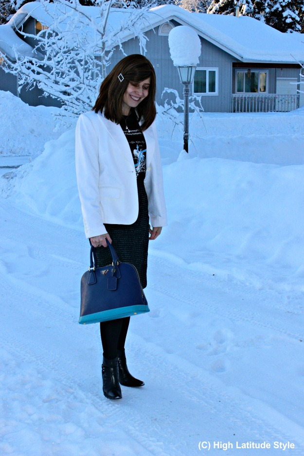 over 50 years old stylist in winter work outfit with white blazer and gray skirt