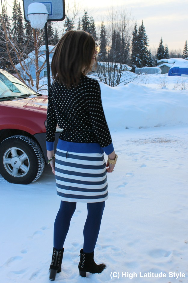 fashion over 40 woman in winter office look with mixed pattern