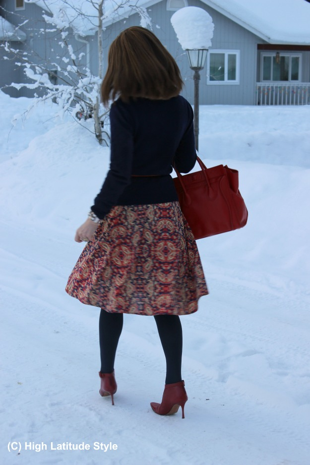 #fashionover50 winter look with flare skirt and second hand bag and booties
