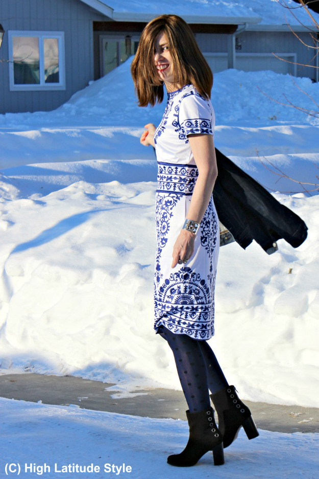 #styleover50 woman in winter to spring transition look with a blue and white sheath