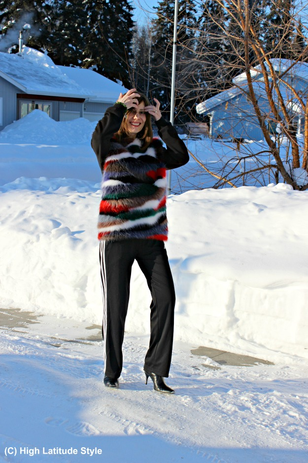 mature style blogger in striped sweater and sport trousers