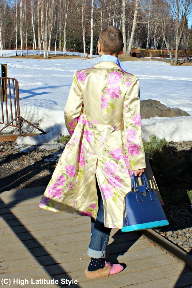 style book author in chic floral coat