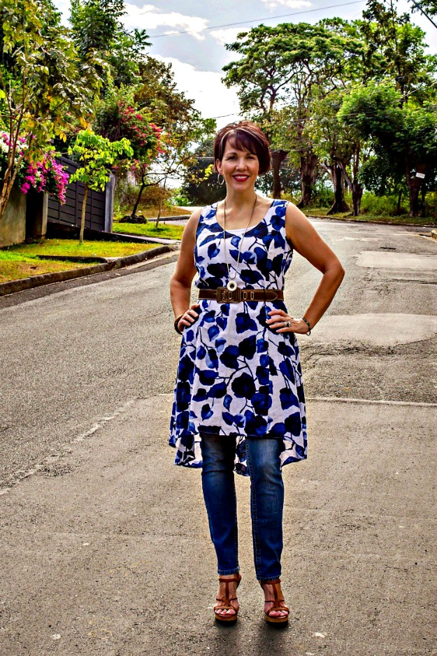 #trendsover40 woman wearing a floral dress over pants