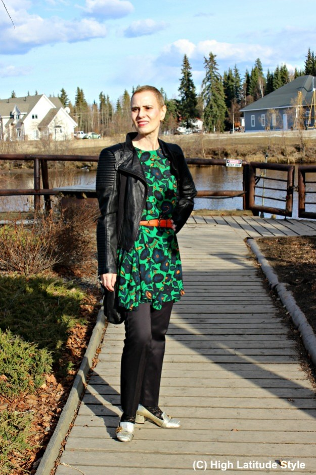 midlife woman in floral dress with black pants