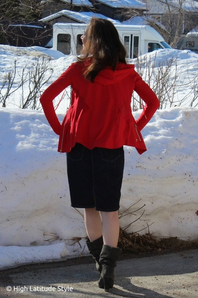 fashion blogger in red hoodie and blue skirt gray booties