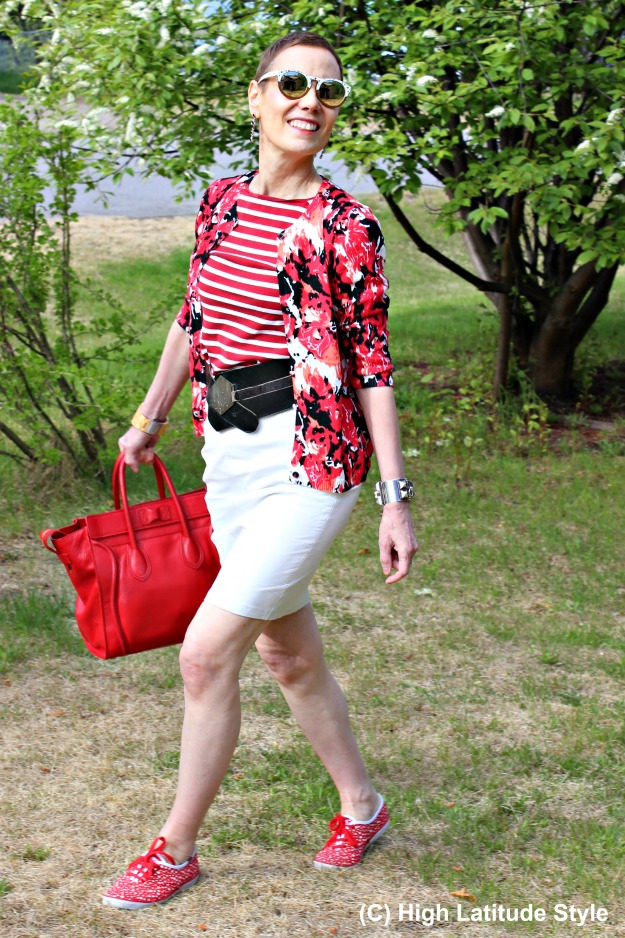 #styleover50 woman in red white black summer look with white and plain wood patterned Winkwood eye wear
