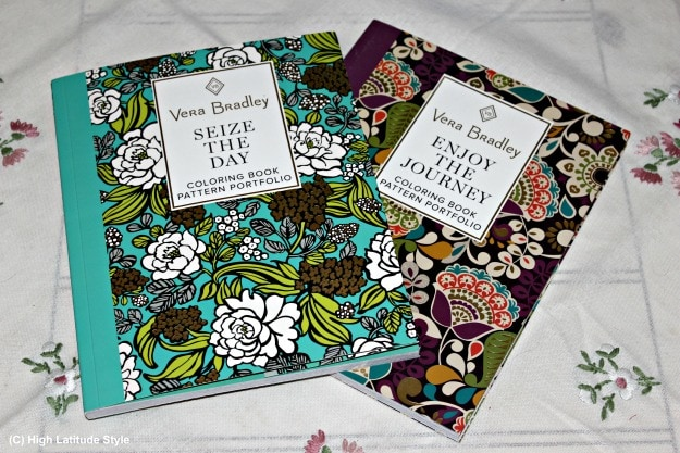 photo showing 2 Vera Bradley coloring books on a coffee table