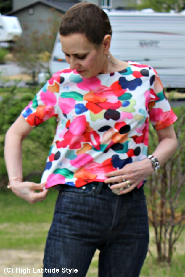 midlife style blogger in top with zig-zag hem