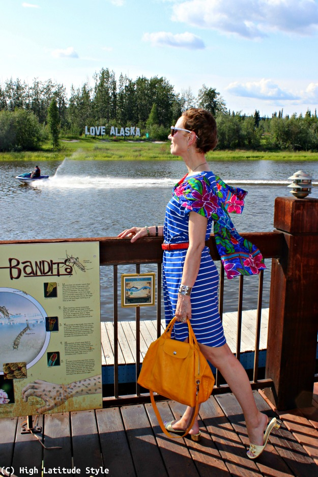 fashion blogger over 40 posing at a river in casual stripes summer dress