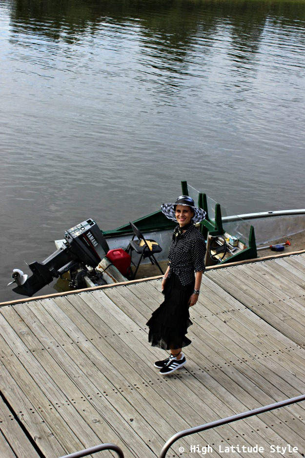 #maturestyle woman in black and white outfit on a dock