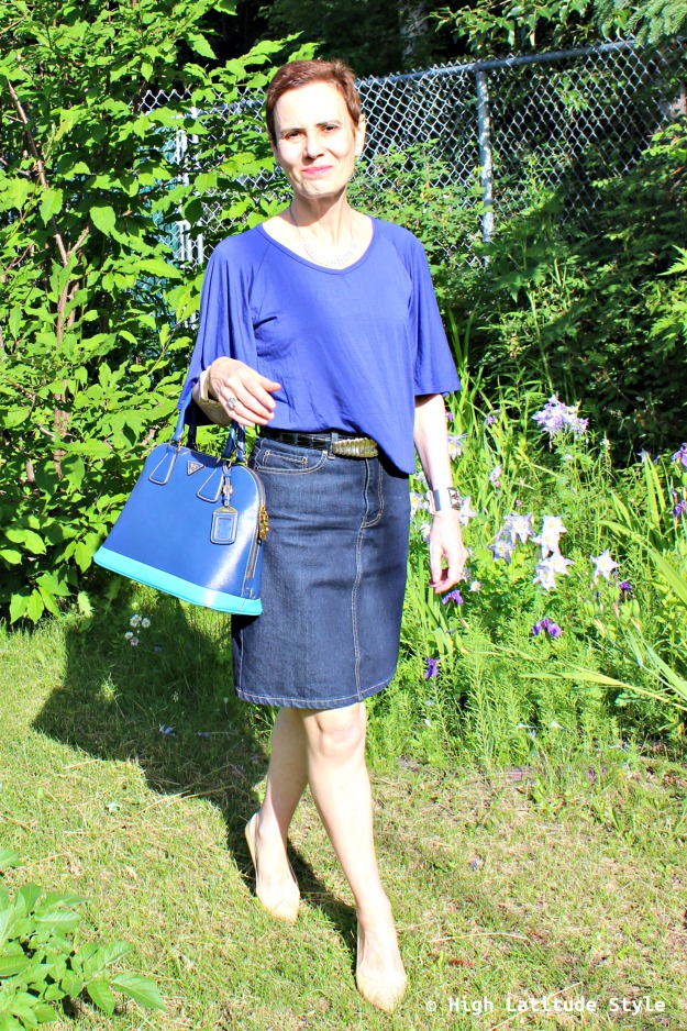 fashion blogger over 50 in blue trendy statement sleeve top pencil jeans skirt
