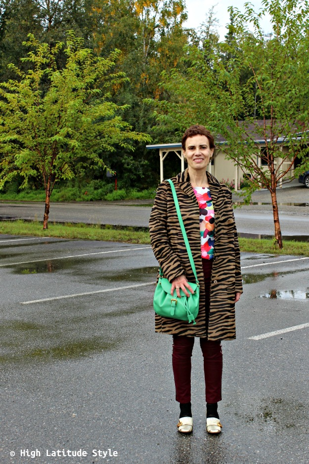over 50 years old woman in zebra coat and grassy saddle bag