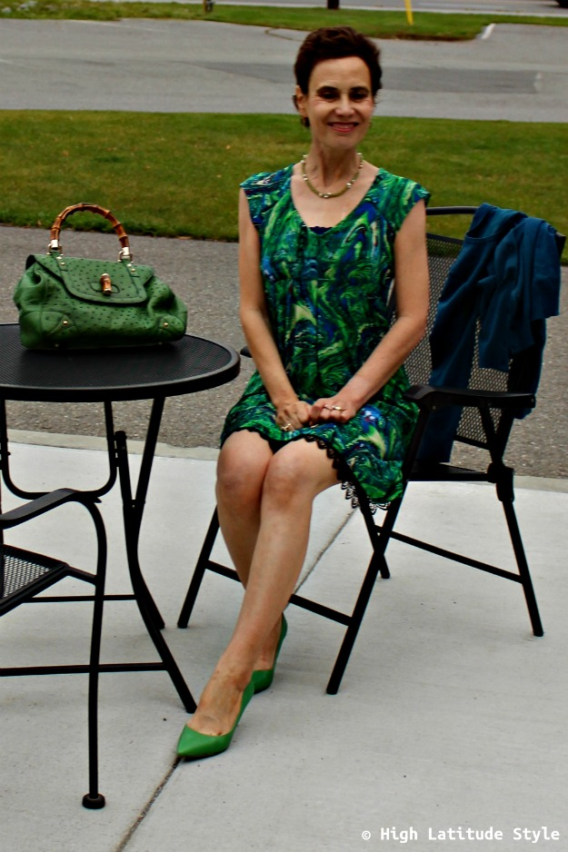 #styleover50 woman in green dress with cardigan and Gucci bag