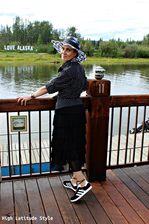 #fashionover50 woman in black and white outfit with hat