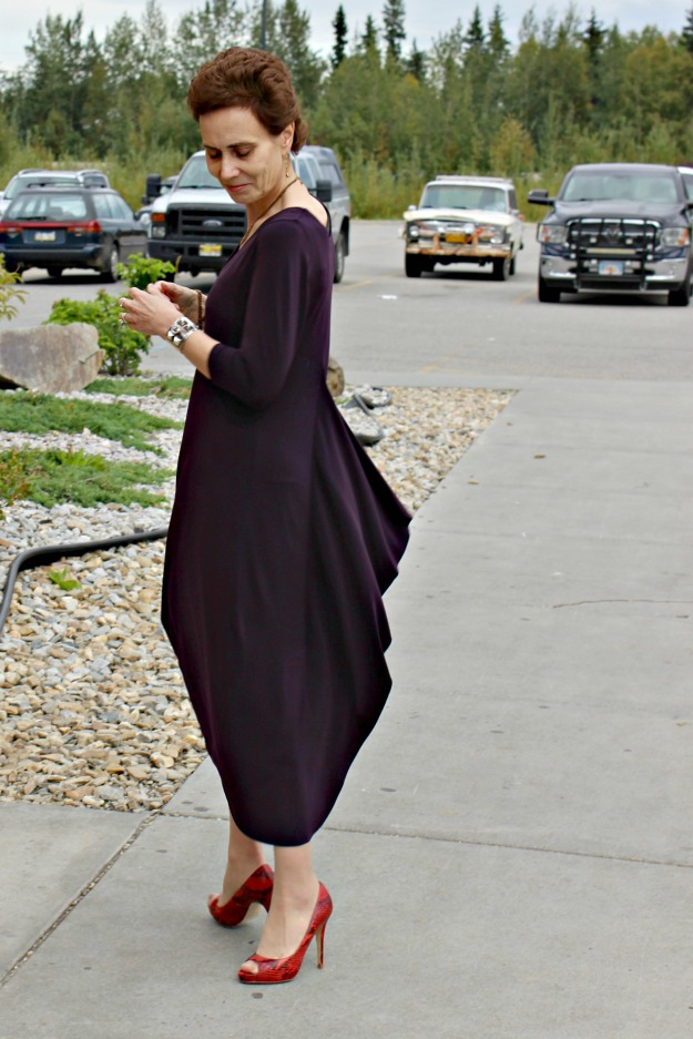 #styleover40 woman twirling in a dress with train