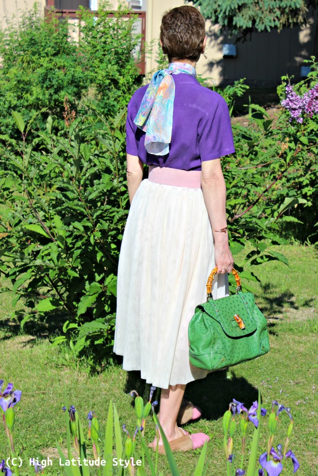 #styleover40 woman in summer blush skirt, purple shirt with colorful scarf