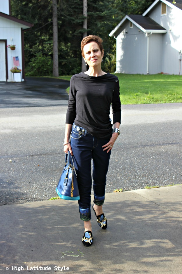 #styleover40 woman in Soft Surroundings outfit of cuffed jeans, earrings mules and top