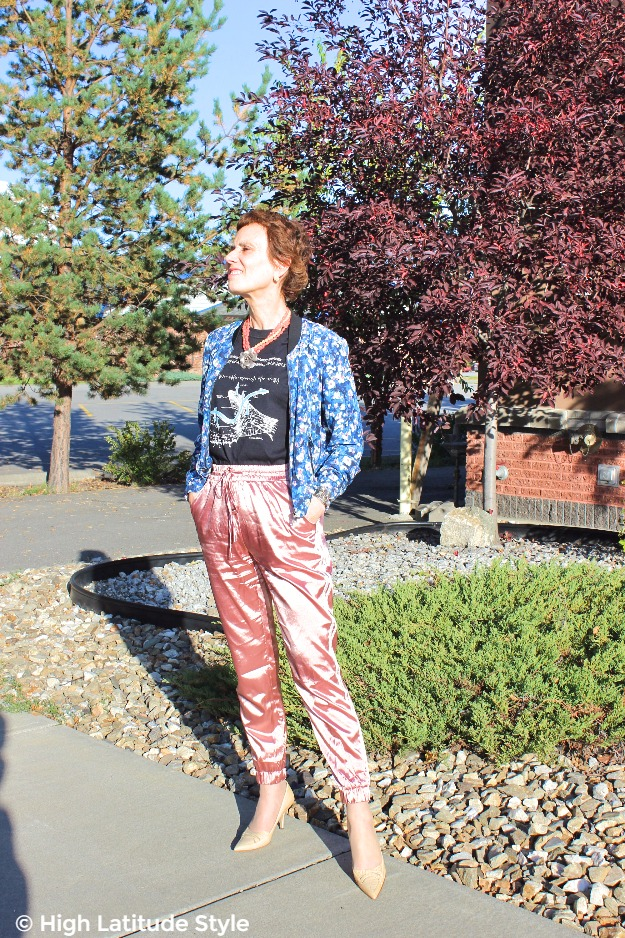 woman over 40 in satin joggers and floral bomber