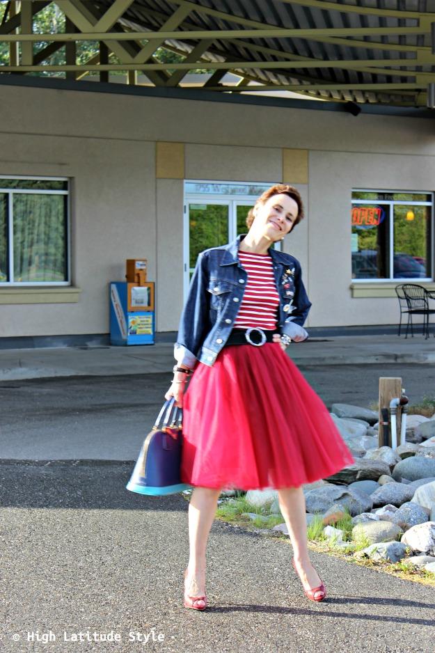 style book author in tutu, denim jacket, striped sweater