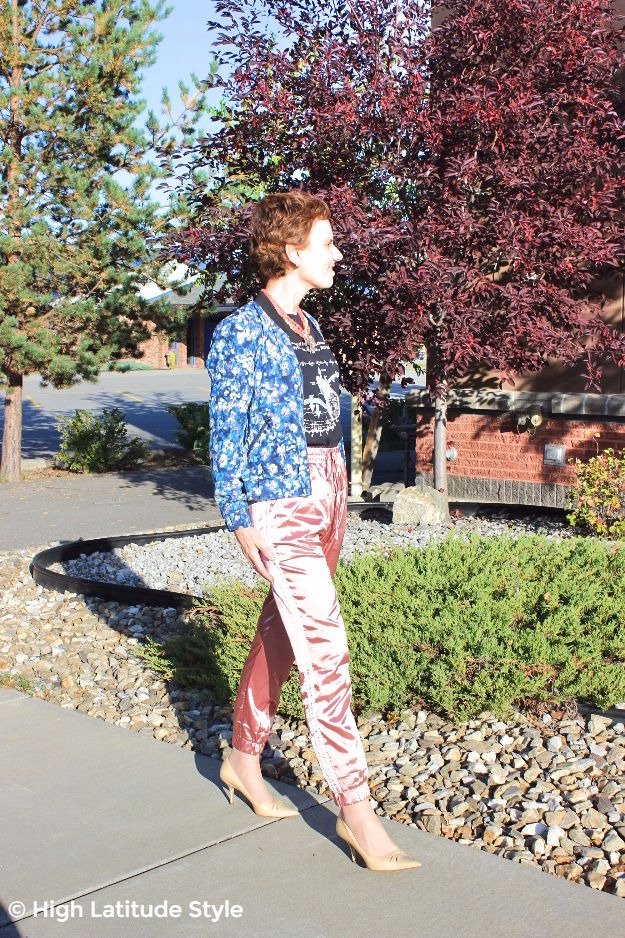 Dryel brand ambassador in athleisure pants with floral print jacket
