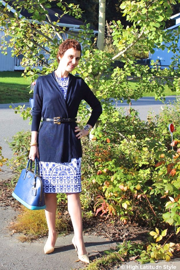 #styleover50 woman wearing a cardigan over blue and white sheath