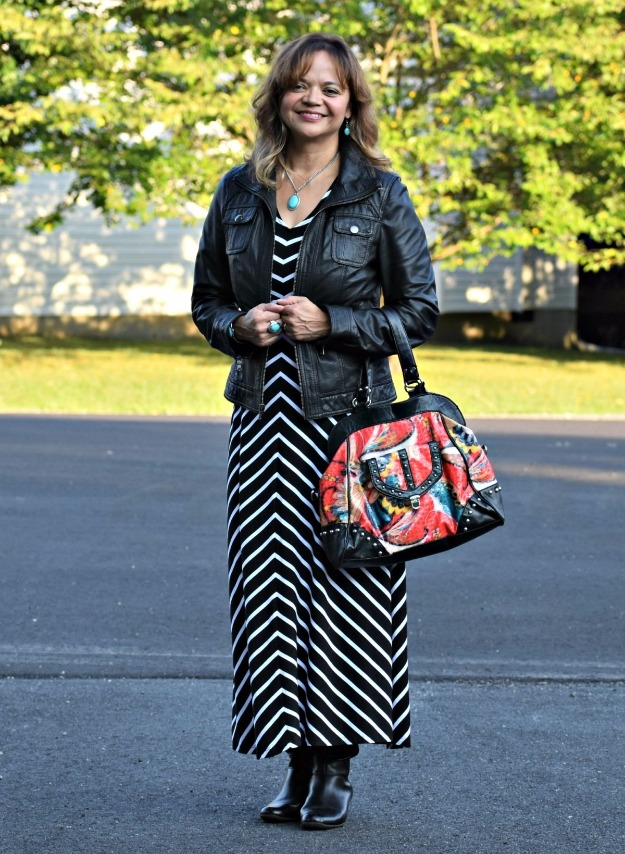 40+ woman in maxi dress with moto jacket