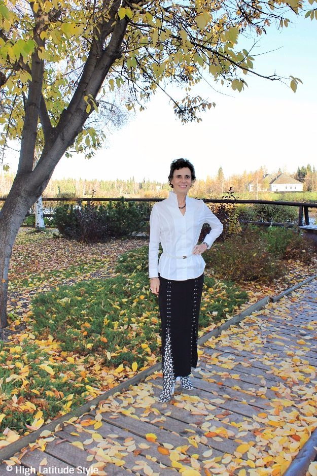 posh chic midlife woman in Missok travel friendly skirt and shirt black and white outfit