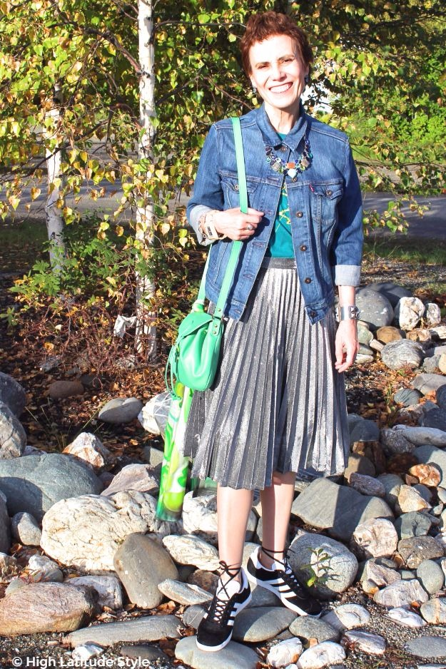 #fallstyle mature woman in pleated skirt with sneakers