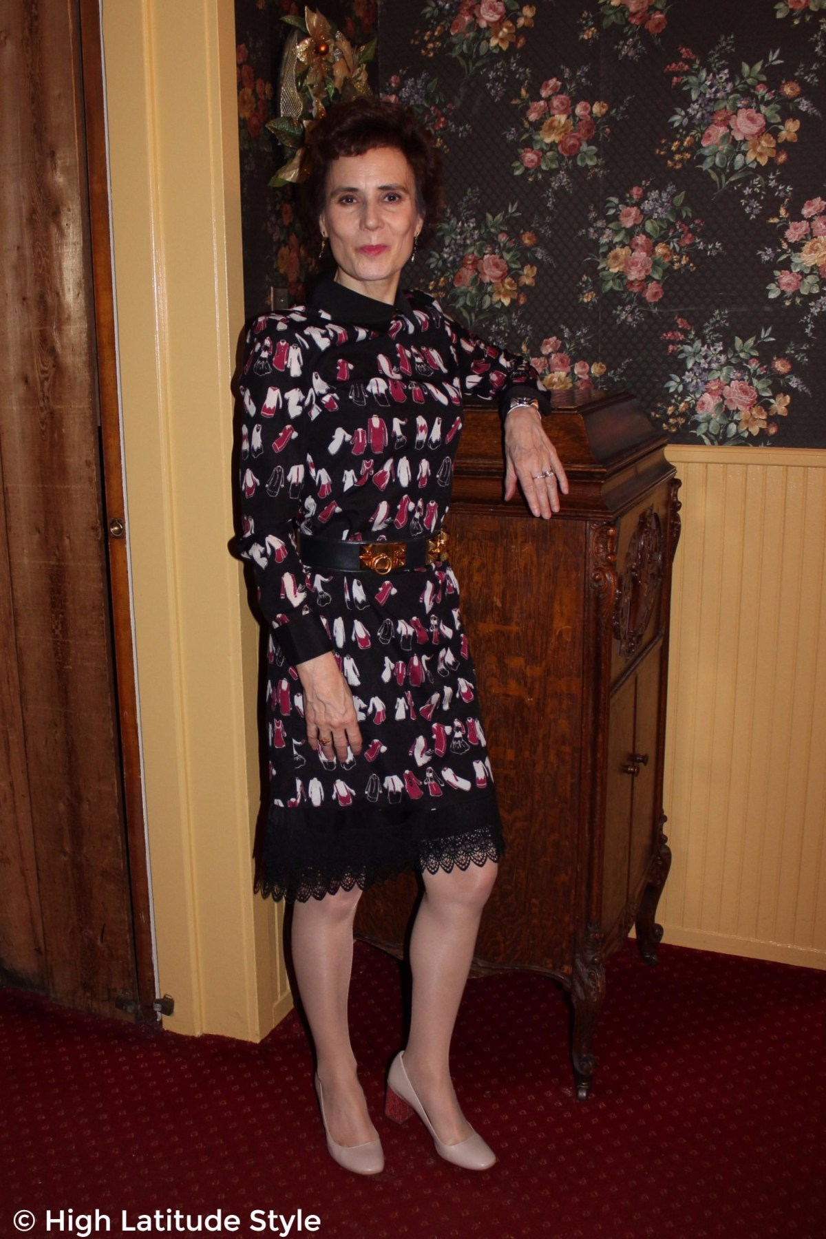 posh chic midlife woman in printed dress over lace hem underskirt