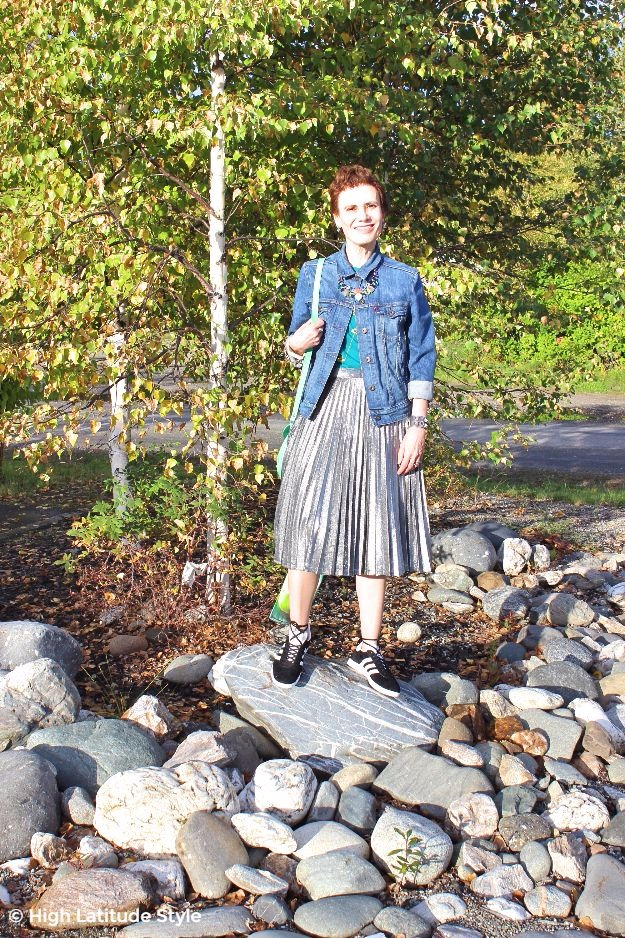 midlife woman in posh chic street style with silver skirt