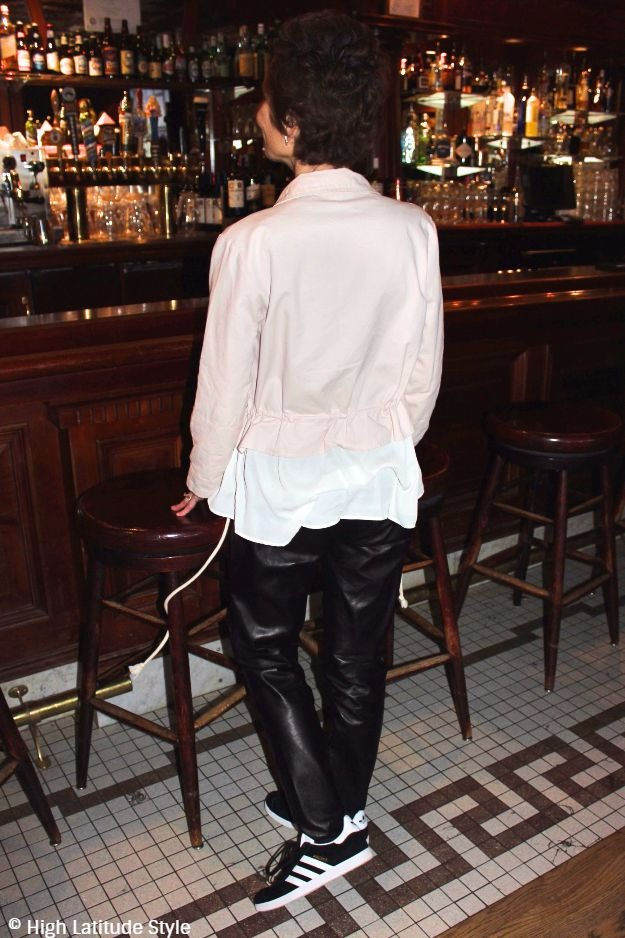#styleover50 Woman in a casual going out look in a bar