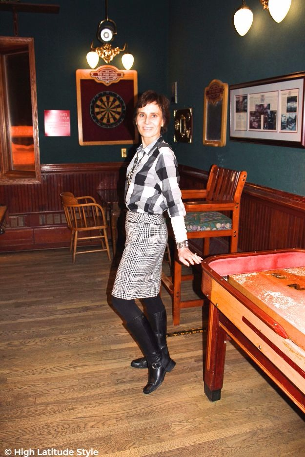 mature style blogger wearing plaid with hounds tooth and equestrarian footwear