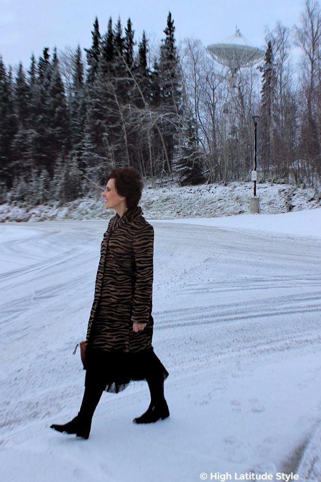 #maturestyle woman in zebra print coat and posh riding boots