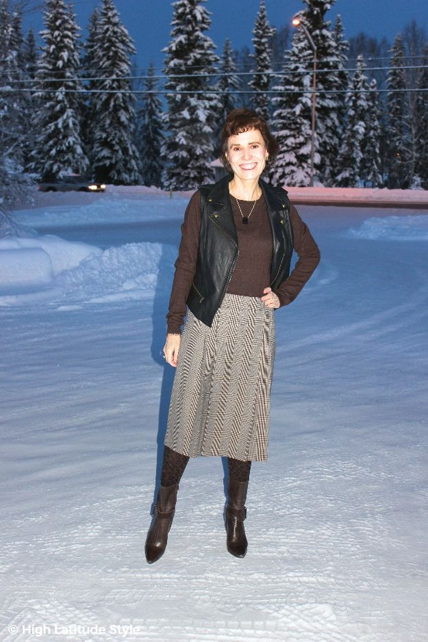 #midlifestyle woman in leather vest with glen check skirt
