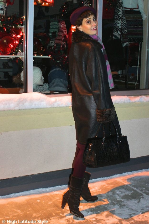 #midlifestyle #styleover50 woman in a winter shopping outfit at a mall