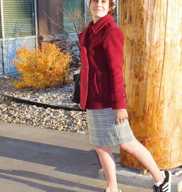 #fashionover50 midlife woman in sneakers with skirt