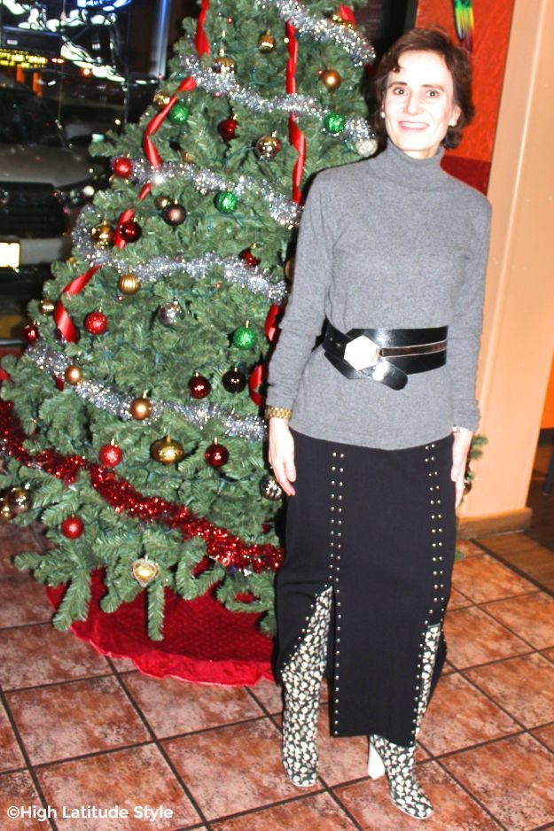 #midlifestyle woman in studded skirt with floral boots