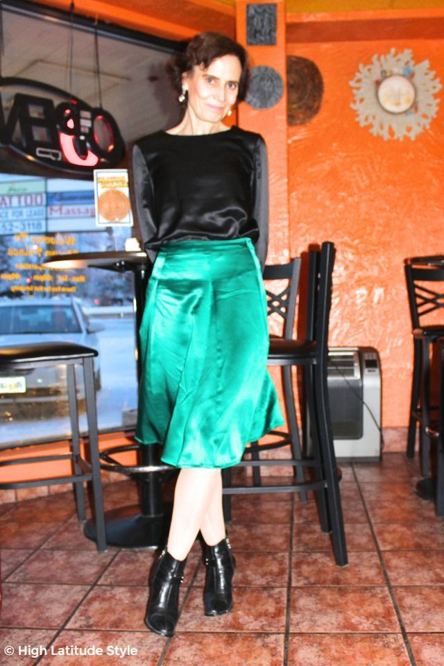 fashionista over 50 in teal skirt and black shirt