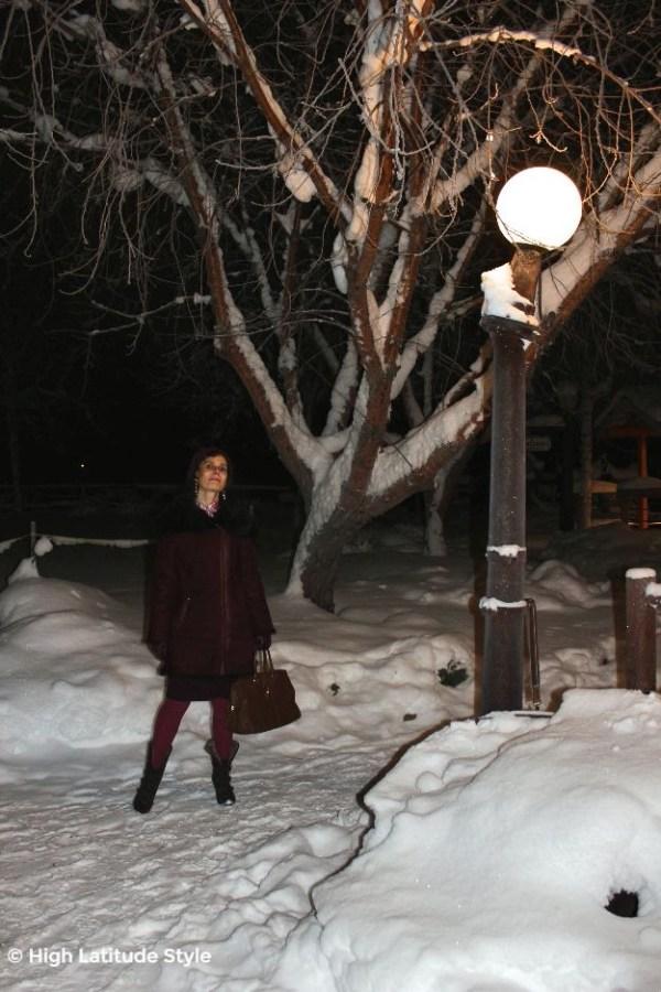 #fashionover50 #trendsforover40 woman in asymmetric coat in winter scene