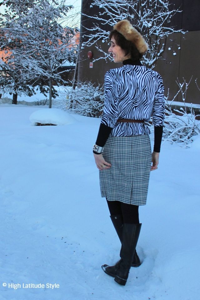 #fashionover40 midlife woman in black and white office look standing in the snow