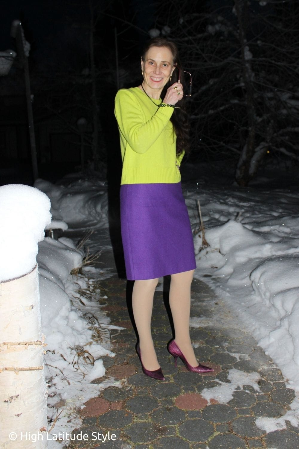 style blogger in yellow purple color blocked sweater skirt look with distressed pumps