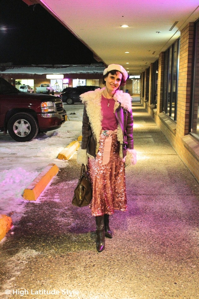 January date night look with motorcycle shearling coat with sequin skirt and booties
