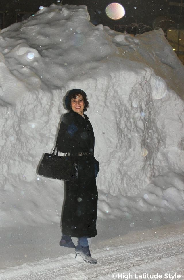 #fashionover50 woman standing in the cold in a shearling coats with stylish accessories