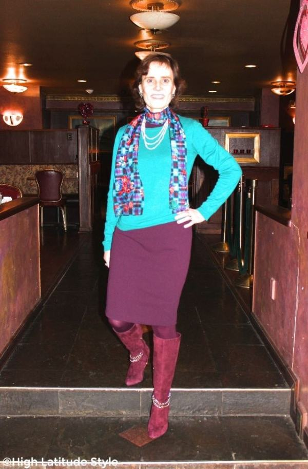 #fashionover50 midlife woman looking posh chic in a dress with sweater, boots and scarf